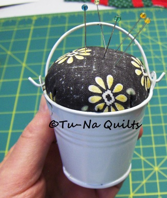 "The Pincushion Pail is 2.25"" tall and 2"" wide at the top."